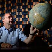 Peter Piot, one of the co-discoverers of the Ebola virus in 1976 during its first outbreak, in Zaire, is interviewed at his office in London on Wednesday. | AFP-JIJI