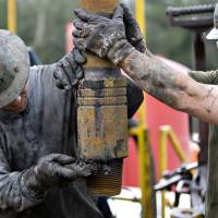 Oil workers drill in shale deposits in Bradford County, Pennsylvania, in 2010. | BLOOMBERG