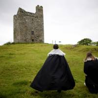 'Game of Thrones' tourists visit Audleys field and castle, used to film the arrival of King Robert Baratheon and his retinue at Winterfell, in Strangford, Northern Ireland, on June 13. | AP