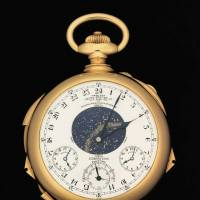Auction house Sotheby's on Thursday shows off the Henry Graves Supercomplication timepiece, which it plans to auction in November. The 'Holy Grail' of watches will be up for sale in November. | AFP-JIJI