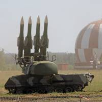 A Buk M2 missile system is displayed at a military show during the international 'Technologies in machine building 2010' forum in Zhukovsky, Russia, in June 2010. The U.S. has said it believes Malaysia Airlines Flight MH17 was brought down by a Buk missile, which is also known as an SA-11, that was fired from an area of eastern Ukraine controlled by pro-Russian separatists. | AP