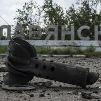 Part of a mortar shell is seen in front of a sign that reads 'Slovyansk,' after heavy fighting between pro-Russian fighters and Ukrainian government troops just outside the eastern city on Wednesday. The rebels fled Slovyansk, a former stronghold, over the weekend after Kiev troops mounted an offensive, leaving behind a city heavily damaged by fighting and riven by vehemently differing views about its future. | AP