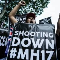 A Malaysian youth shouts slogans during a rally outside the Russian Embassy in Kuala Lumpur on Tuesday in frustration over the downing of Malaysia Airlines Flight MH17 carrying 298 people from Amsterdam to Kuala Lumpur in an area of eastern Ukraine controlled by Pro-Russian separatists. | AFP