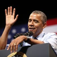 U.S. President Barack Obama gestures as he speaks about the economy during a visit to Austin, Texas, on July 10. | REUTERS