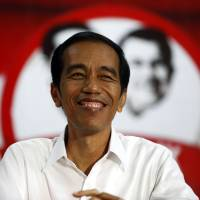 Joko Widodo gives a speech to supporters in Serang, Banten province, on Wednesday. | REUTERS