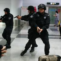 Security forces take part in an anti-terrorism drill at Meilan International Airport in Haikou, in south China's Hainan province, on June 12, days after attackers in the country's Xinjiang region killed 39 people in a suicide raid. | AFP-JIJI