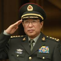 Central Military Commission Vice Chairman Gen. Xu Caihou salutes during a welcoming ceremony at the Pentagon on Oct. 27, 2009. The former high-ranking Chinese military official has been accused of accepting bribes and has been expelled from the ruling Communist Party, state news agency Xinhua said on Monday, in the military's biggest corruption scandal in almost a decade. | REUTERS