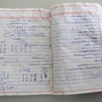 This notebook belonging to an al-Qaida fighter, found in a former militant training camp in southern Yemen in May, contains diagrams of various types of ambushes. | REUTERS