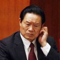 Zhou Yongkang, at the time China's public security minister, attends the 17th National Congress of the Communist Party in Beijing in October 2007.   REUTERS