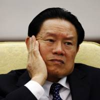 Zhou Yongkang, China's public security minister at the time, attends the Hebei delegation discussion sessions at the 17th National Congress of the Communist Party of China at the Great Hall of the People in Beijing in October 2007. | REUTERS