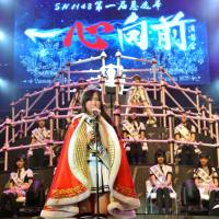 Wu Zhenhan, winner of the first popularity contest held by AKB48's Shanghai-based sister group, SNH48, delivers a speech after the results were released Saturday in Shanghai. | KYODO
