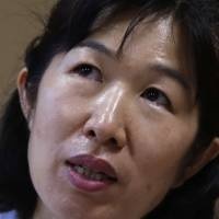 Misa Morimoto cries in Otsuki, Yamanashi Prefecture, on July 15, as she recounts the story of her identical twin Miho, who vanished from their home in Kofu in 1984. | REUTERS