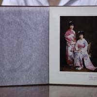 Misa Morimoto, the 50-year-old identical twin of Miho Yamamoto, shows a photograph of Miho (standing) and herself in kimono on their 20th birthday in 1984, during an interview in Otsuki, Yamanashi Prefecture, on July 15. | REUTERS