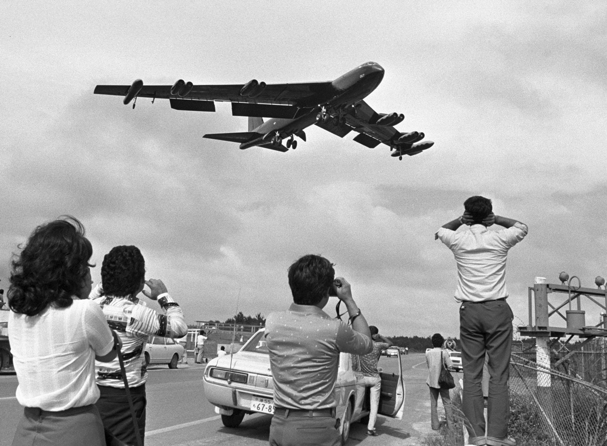 A B-52 bomber flies over the U.S. military's Kadena Air Base in Okinawa Prefecture in May 1976. | KYODO