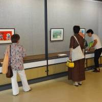 People view original drawings from the manga 'Barefoot Gen' Wednesday at the Maruki Gallery for the Hiroshima Panels in Higashimatsuyama, Saitama Prefecture. | KYODO