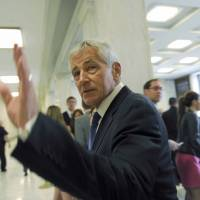 U.S. Defense Secretary Chuck Hagel arrives on Capitol Hill in Washington on June 11 to testify before the House Armed Services Committee. | AP