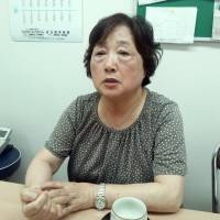 Reiko Ozawa, who heads the self-help group Hoshi no Kai (Group of Reshining Stars), recounts the 11 years she looked after her husband after he was diagnosed with early onset dementia at age 54, in her office in Tokyo on June 18. | TOMOHIRO OSAKI