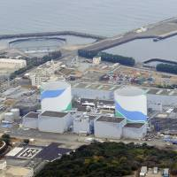 Kyushu Electric Power Co.'s Sendai Nuclear Power Plant in Satsumasendai, Kagoshima Prefecture, expected to go back online as early as September, is seen in January. Residents in the neighboring city of Ichikikushikino have complained that government plans on their mass evacuation in the event of a nuclear disaster have missed key points. | KYODO