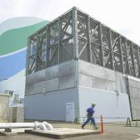 A water tank constructed with a reinforced outer shell to protect it from tornadoes is seen at the Sendai nuclear power plant in Satsumasendai, Kagoshima Prefecture, on July 8. | KYODO