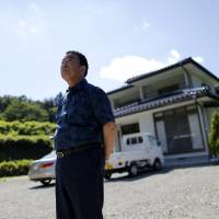 Mikio Watanabe's house in Kawamata, Fukushima Prefecture, remains radioactive and all he can do is maintain it during short visits. Being unemployed and forced to live elsewhere was too much for his wife, who burned herself to death during what she thought would be their final stay at the house. | REUTERS