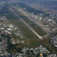 The U.S. Marine Corps Air Station Futenma, seen in February, is located within the densely populated city of Ginowan, Okinawa Prefecture. | KYODO