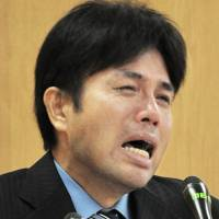 Ryutaro Nonomura, a member of the Hyogo Prefectural Assembly, cries during a press conference in Kobe on July 1 after being questioned about his expense reports. | KYODO
