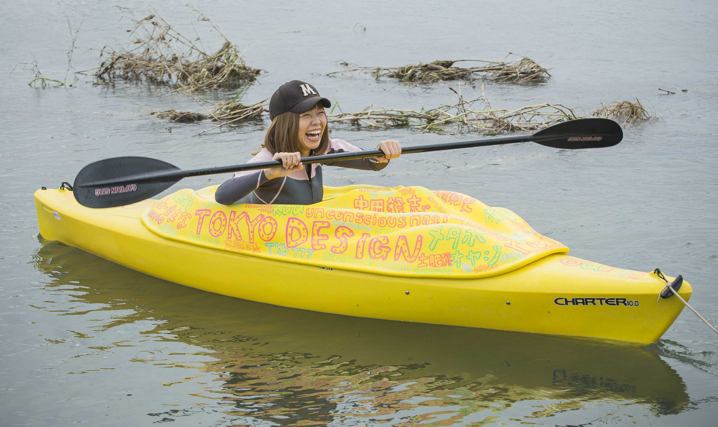 Japanese artist Megumi Igarashi, known as Rokudenashi-ko, paddles in her kayak modeled on her vagina in Tama River in Tokyo Oct. 19, 2013. Igarashi, 42, says she was challenging a culture of 'discrimination' against discussion of the vagina in Japanese society. | REUTERS