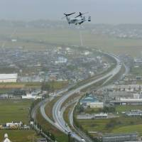 A U.S. Marine Corps MV-22 Osprey cruises over the city of Takashima, Shiga Prefecture, in October 2013. | KYODO