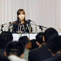 Assisted by lawyer Hideo Miki, Riken cytologist Haruko Obokata attends a news conference in April at a hotel in the city of Osaka. | KYODO
