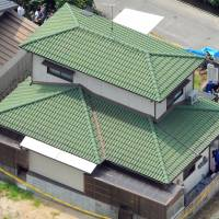 The home of Takeshi Fujiwara, who was arrested on suspicion of kidnapping and confining a schoolgirl in Kurashiki, Okayama Prefecture, is seen Monday in the city of Okayama | KYODO