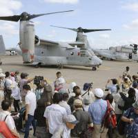 Visitors snap away at MV-22 Osprey on display Sunday at the 28th Sapporo air show, held by the Hokkaido Aeronautic Association at the Ground Self-Defense Force's Camp Okadama. | KYODO