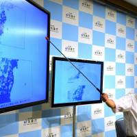 Meteorological Agency officer Yasuhiro Yoshida speaks at a news conference in Tokyo on Saturday after a 6.8-magnitude earthquake struck off the Pacific coast of Tohoku, generating minor tsunami. | AFP
