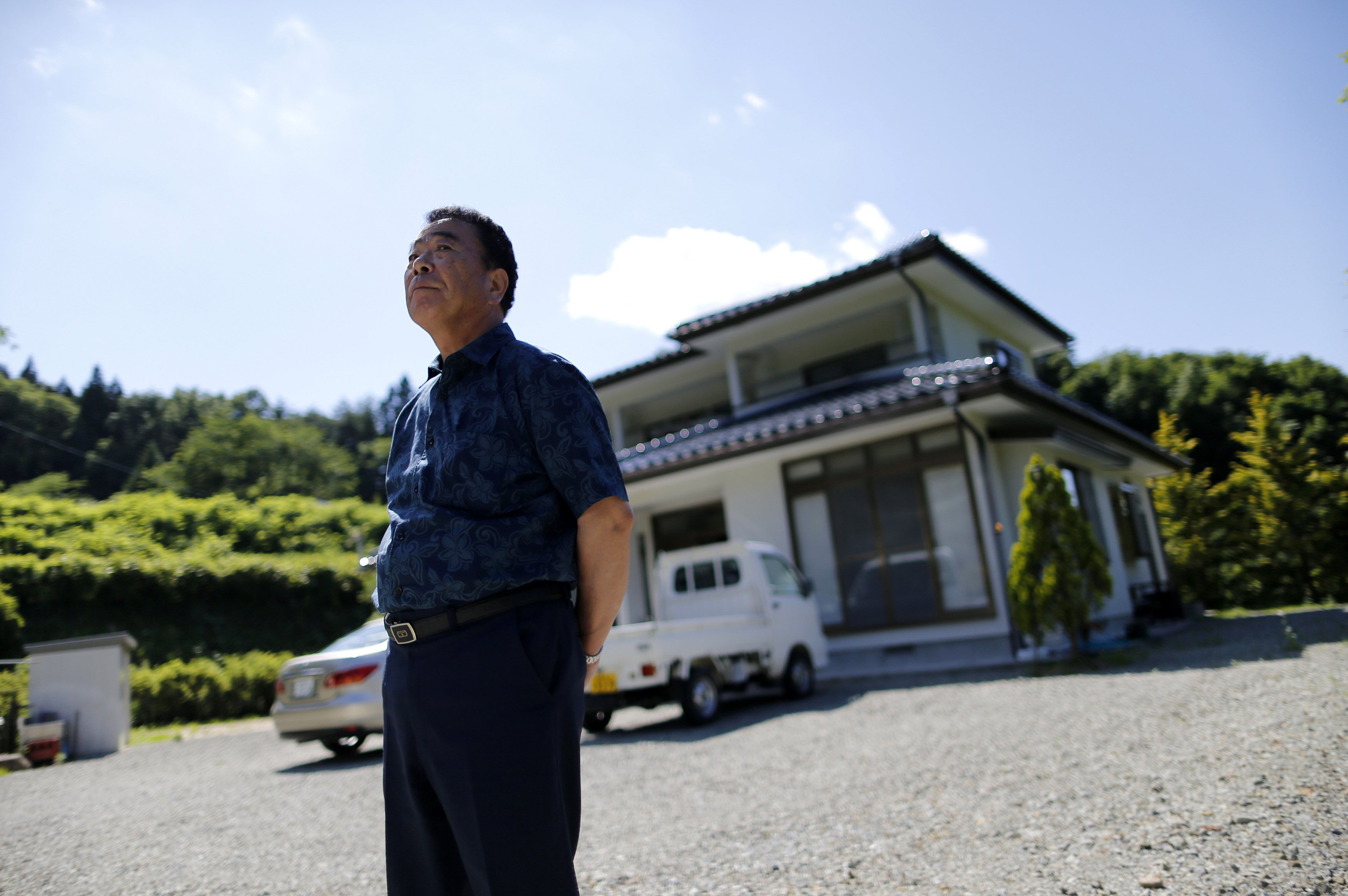 Mikio Watanabe's house in Kawamata, Fukushima Prefecture, remains in an exclusion zone and all he can do is maintain it during short visits. Being unemployed and forced to live elsewhere was too much for his wife, who burned herself to death during what she thought would be their final stay at the house. | REUTERS