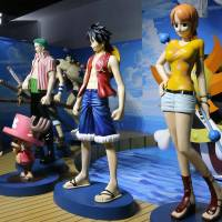 Figurines from the 'One Piece' manga are lined up Thursday for an exhibition in Seoul at the government-run War Memorial of Korea, which subsequently canceled the event. | KYODO