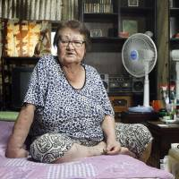 Cho Myung-ja, 76, describes her life as a prostitute serving U.S. military personnel stationed in South Korea, in her room in a shack outside Camp Humphreys, a U.S. military garrison, in Pyeongtaek, South Korea, on Friday. | REUTERS