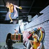 Figurines from the 'One Piece' manga are lined up July 10 for an exhibition at the government-run War Memorial of Korea in Seoul. The event was canceled, but Friday a South Korean court ruled it should be held. | KYODO