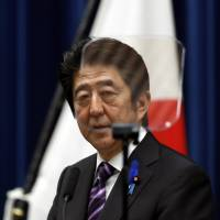Prime Minister Shinzo Abe explains his Cabinet's defense decision Tuesday at his official residence. | REUTERS