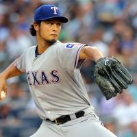 Five-inning loss: Texas starter Yu Darvish throws a pitch against New York on Wednesday night. The Yankees won 2-1. | REUTERS/USA TODAY SPORTS