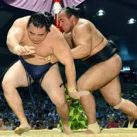 Stepping stone: Egyptian maegashira Osunaarashi (right) overpowers Kakuryu on Thursday at the Nagoya Grand Sumo Tournament, beating a yokozuna for the first time. | KYODO