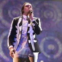 Main stage: Arcade Fire vocalist Win Butler performs on the Green Stage on Saturday.   CHIEKO KATO