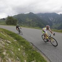 Climb and conquer: Poland's Rafal Majka leads during the 17th stage of the Tour de France on Wednesday. Majka won in a time of 3 hours, 35 minutes, 23 seconds. | AP