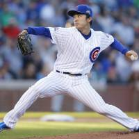 Pounded: Chicago starter Tsyuoshi Wada fires a pitch against San Diego in the first inning on Wednesday at Wrigley Field. | AP