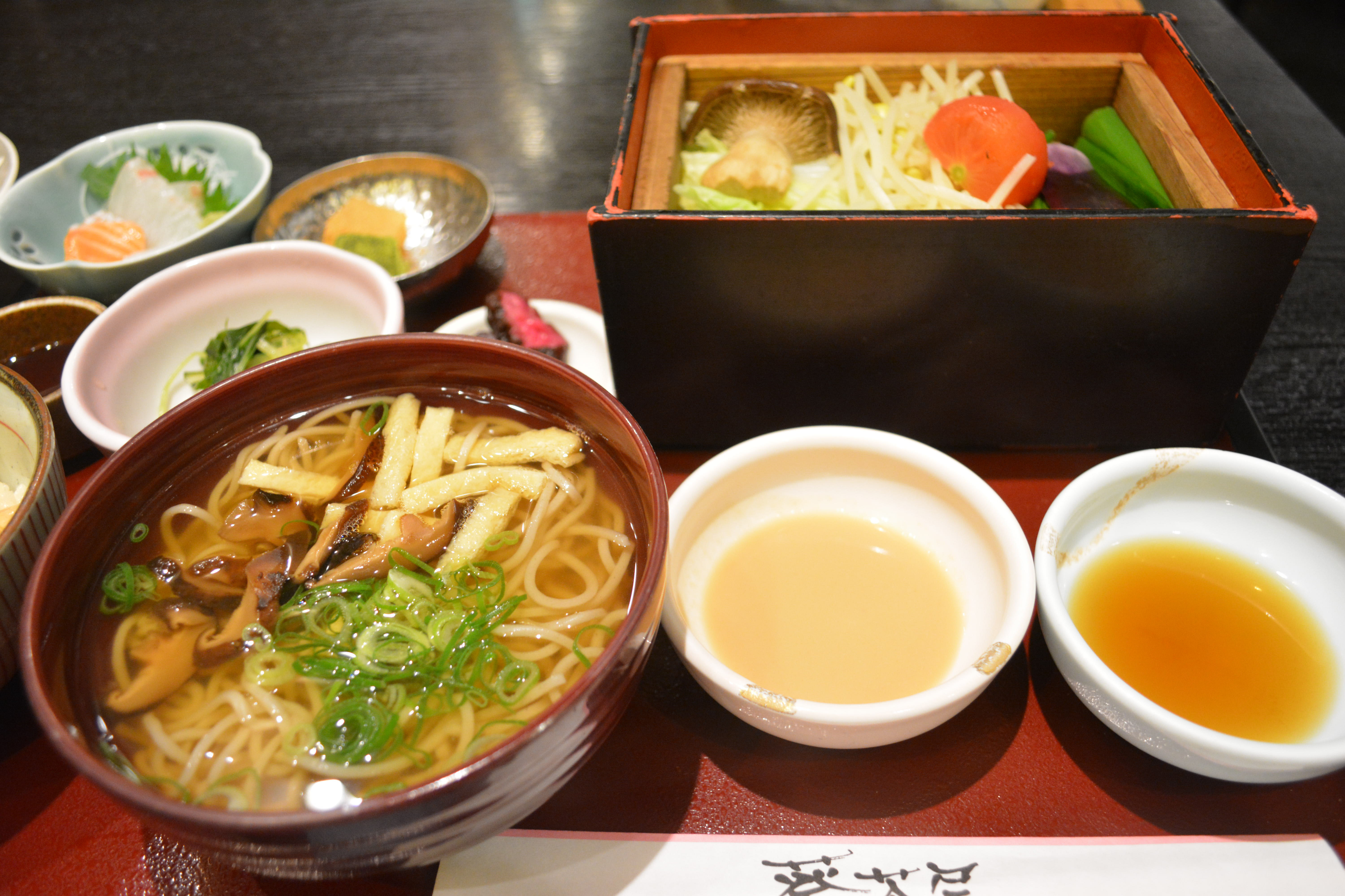 Big lunch: One of many generous flower-themed lunch sets at Aoi-jaya, including the specialty seiro bushi bamboo-steamer dish at top right. | J.J. O'DONOGHUE
