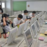 Teach to the test: Students at an Osaka high school take a TOEFL iBT practice exam. The Osaka Board of Education is introducing teaching toward the Internet-based TOEFL iBT exam to nine high schools next year, and eight more in 2016.   | J.J. O'DONOGHUE