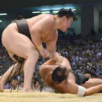 What he does best: Yokozuna Hakuho records a victory against Osunaarashi on Sunday at the Nagoya Grand Sumo Tournament.  | KYODO