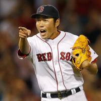 One for you: Boston reliever Koji Uehara reacts after getting the final out in a 2-1 victory over Kansas City on Saturday. | KYODO