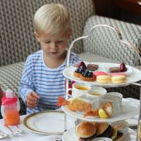 Toddlers tuck in: The Kid's Afternoon Tea set at The Ritz Carlton, Tokyo includes mini burgers, vegetable potage, fried prawns and various sweets. | DANIELLE DEMETRIOU