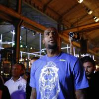 Short deal: LeBron James attends a promotional event in Rio de Janeiro on Saturday. James signed a two-year contract to return to the Cleveland Cavaliers before leaving the U.S. | AP