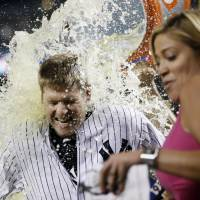 Cool your jets: Yankees infielder Chase Headley is doused with Gatorade after his game-winning hit on Tuesday. | AP