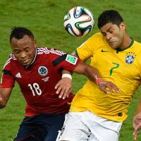 Hulkamania: Brazil's Hulk (right), seen competing against Colombia during their quarterfinal match at the World Cup on Friday, and the rest of the Selecao have to find a way to cope without star striker Neymar against Germany in the semifinals. | AFP-JIJI